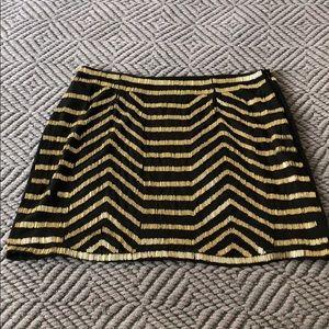 Hand beaded gold and black skirt!
